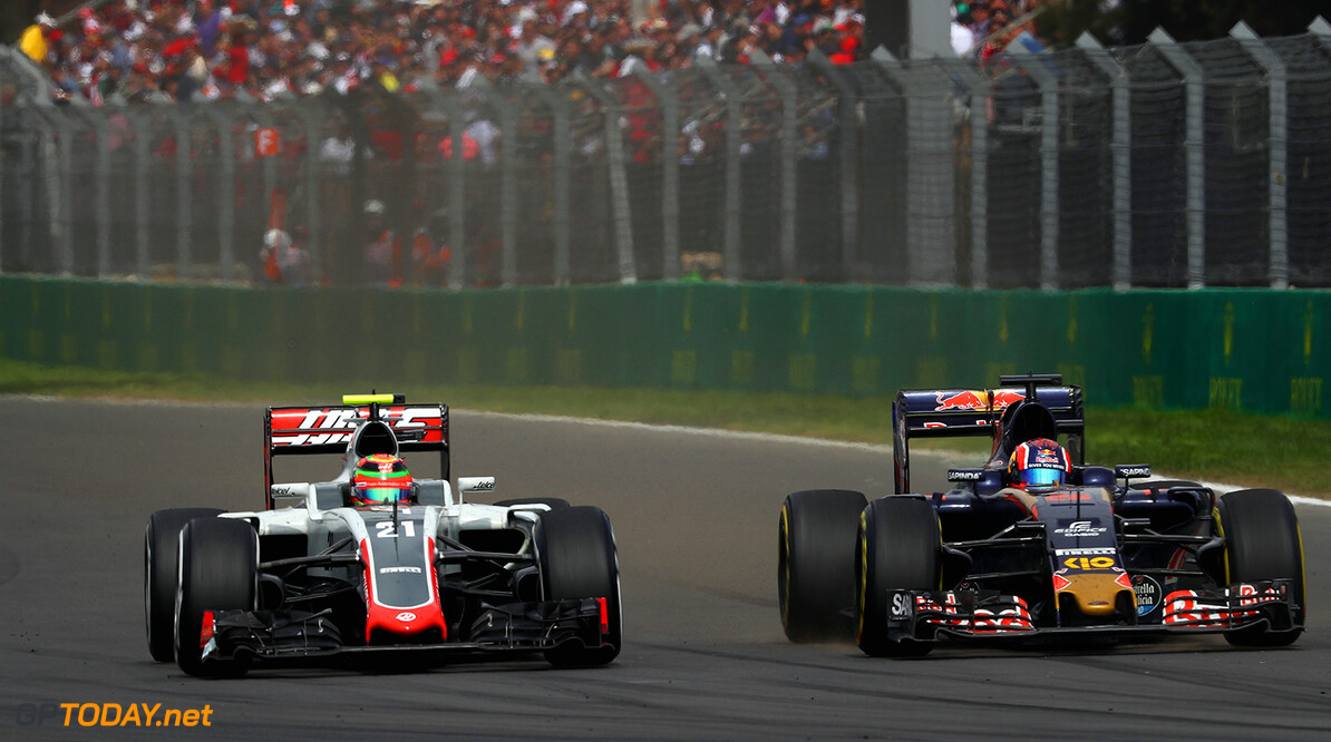 MEXICO CITY, MEXICO - OCTOBER 30:  Esteban Gutierrez of Mexico driving the (21) Haas F1 Team Haas-Ferrari VF-16 Ferrari 059/5 turbo battles with Daniil Kvyat of Russia driving the (26) Scuderia Toro Rosso STR11 Ferrari 060/5 turbo during the Formula One Grand Prix of Mexico at Autodromo Hermanos Rodriguez on October 30, 2016 in Mexico City, Mexico.  (Photo by Clive Mason/Getty Images) // Getty Images / Red Bull Content Pool  // P-20161030-00754 // Usage for editorial use only // Please go to www.redbullcontentpool.com for further information. //  F1 Grand Prix of Mexico Clive Mason Mexico City Mexico  P-20161030-00754