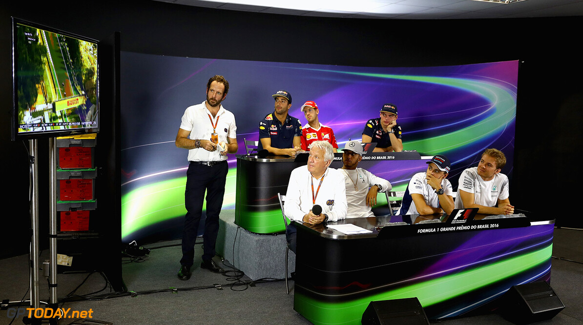 SAO PAULO, BRAZIL - NOVEMBER 10:  FIA Race Director, Charlie Whiting makes an appearance in the Drivers Press Conference featuring (back row, left to right) Daniel Ricciardo of Australia and Red Bull Racing, Sebastian Vettel of Germany and Ferrari, Max Verstappen of Netherlands and Red Bull Racing (front row, left to right) Lewis Hamilton of Great Britain and Mercedes GP, Felipe Massa of Brazil and Williams and Nico Rosberg of Germany and Mercedes GP  during previews for the Formula One Grand Prix of Brazil at Autodromo Jose Carlos Pace on November 10, 2016 in Sao Paulo, Brazil.  (Photo by Clive Mason/Getty Images) // Getty Images / Red Bull Content Pool  // P-20161110-00842 // Usage for editorial use only // Please go to www.redbullcontentpool.com for further information. //  F1 Grand Prix of Brazil - Previews Clive Mason Sao Paulo Brazil  P-20161110-00842