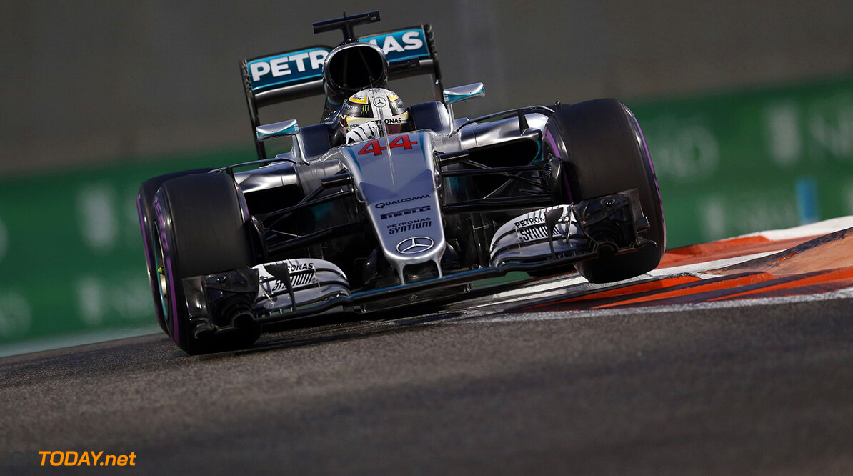 Lewis Hamilton claims pole position for title showdown