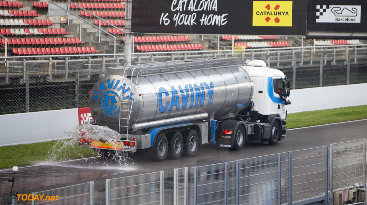 170302RF33823 Barcelona, Spain - 02 March 2017: Trucks watering the track in advance of the wet weather day test during Formula 1 Pre-Season Testing 2017 at Circuit de Barcelona-Catalunya, Barcelona, Spain. Formula 1 Pre-Season Testing 2017 Ronald Fleurbaaij Barcelona Spain  Barcelona Spain Formula 1 Pre-Season Testing 2017 Circuit de Barcelona-Catalunya Sports