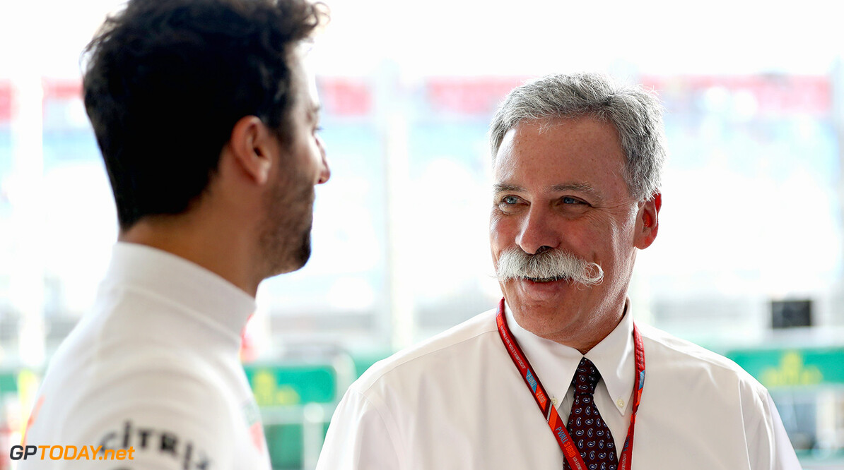 MELBOURNE, AUSTRALIA - MARCH 23:  Daniel Ricciardo of Australia and Red Bull Racing talks with Chase Carey, CEO and Executive Chairman of the Formula One Group in the Red Bull Racing garage during previews to the Australian Formula One Grand Prix at Albert Park on March 23, 2017 in Melbourne, Australia.  (Photo by Mark Thompson/Getty Images) // Getty Images / Red Bull Content Pool  // P-20170323-00448 // Usage for editorial use only // Please go to www.redbullcontentpool.com for further information. //  Australian F1 Grand Prix - Previews Mark Thompson Melbourne Australia  P-20170323-00448