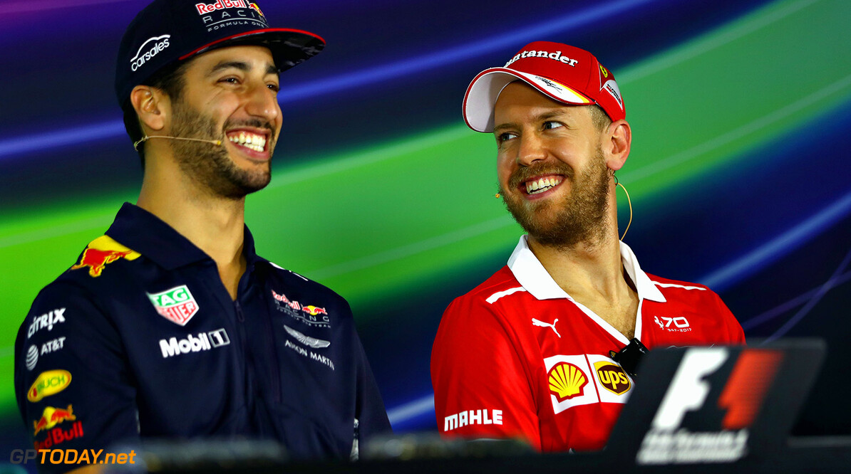 MELBOURNE, AUSTRALIA - MARCH 23:  Daniel Ricciardo of Australia and Red Bull Racing and Sebastian Vettel of Germany and Ferrari talk in the Drivers Press Conference during previews to the Australian Formula One Grand Prix at Albert Park on March 23, 2017 in Melbourne, Australia.  (Photo by Clive Mason/Getty Images) // Getty Images / Red Bull Content Pool  // P-20170323-00321 // Usage for editorial use only // Please go to www.redbullcontentpool.com for further information. //  Australian F1 Grand Prix - Previews Clive Mason Melbourne Australia  P-20170323-00321