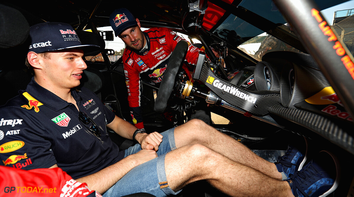 MELBOURNE, AUSTRALIA - MARCH 23:  Max Verstappen of Netherlands and Red Bull Racing talks with V8 Supercar driver Shane Van Gisbergen of New Zealand during previews to the Australian Formula One Grand Prix at Albert Park on March 23, 2017 in Melbourne, Australia.  (Photo by Robert Cianflone/Getty Images) // Getty Images / Red Bull Content Pool  // P-20170323-00560 // Usage for editorial use only // Please go to www.redbullcontentpool.com for further information. //  Australian F1 Grand Prix - Previews Robert Cianflone Melbourne Australia  P-20170323-00560
