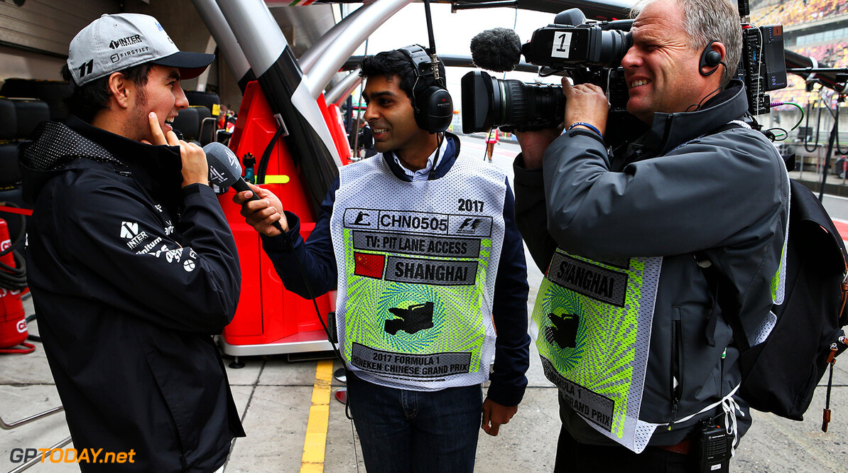 Formula One World Championship Sergio Perez (MEX) Sahara Force India F1 with Karun Chandhok (IND) Channel 4 Technical Analyst. Chinese Grand Prix, Friday 7th April 2017. Shanghai, China. Motor Racing - Formula One World Championship - Chinese Grand Prix - Practice Day - Shanghai, China James Moy Photography Shanghai China  Formula One Formula 1 F1 GP Grand Prix China Chinese Shanghai Shanghai International Circuit JM686 Sergio P?rez Sergio P?rez Mendoza Checo Perez Checo P?rez Portrait GP1702b