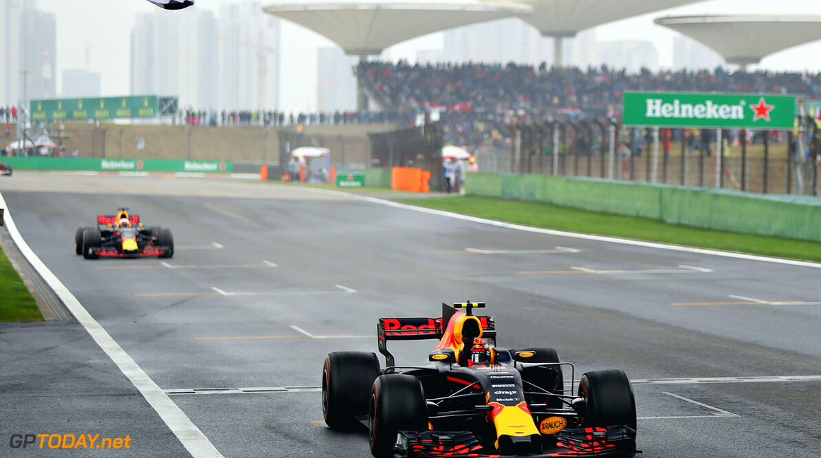 SHANGHAI, CHINA - APRIL 09: Max Verstappen of the Netherlands driving the (33) Red Bull Racing Red Bull-TAG Heuer RB13 TAG Heuer crosses the line ahead of Daniel Ricciardo of Australia driving the (3) Red Bull Racing Red Bull-TAG Heuer RB13 TAG Heuer to take third place during the Formula One Grand Prix of China at Shanghai International Circuit on April 9, 2017 in Shanghai, China.  (Photo by Mark Thompson/Getty Images) // Getty Images / Red Bull Content Pool  // P-20170409-00232 // Usage for editorial use only // Please go to www.redbullcontentpool.com for further information. //  F1 Grand Prix of China Mark Thompson  China  P-20170409-00232