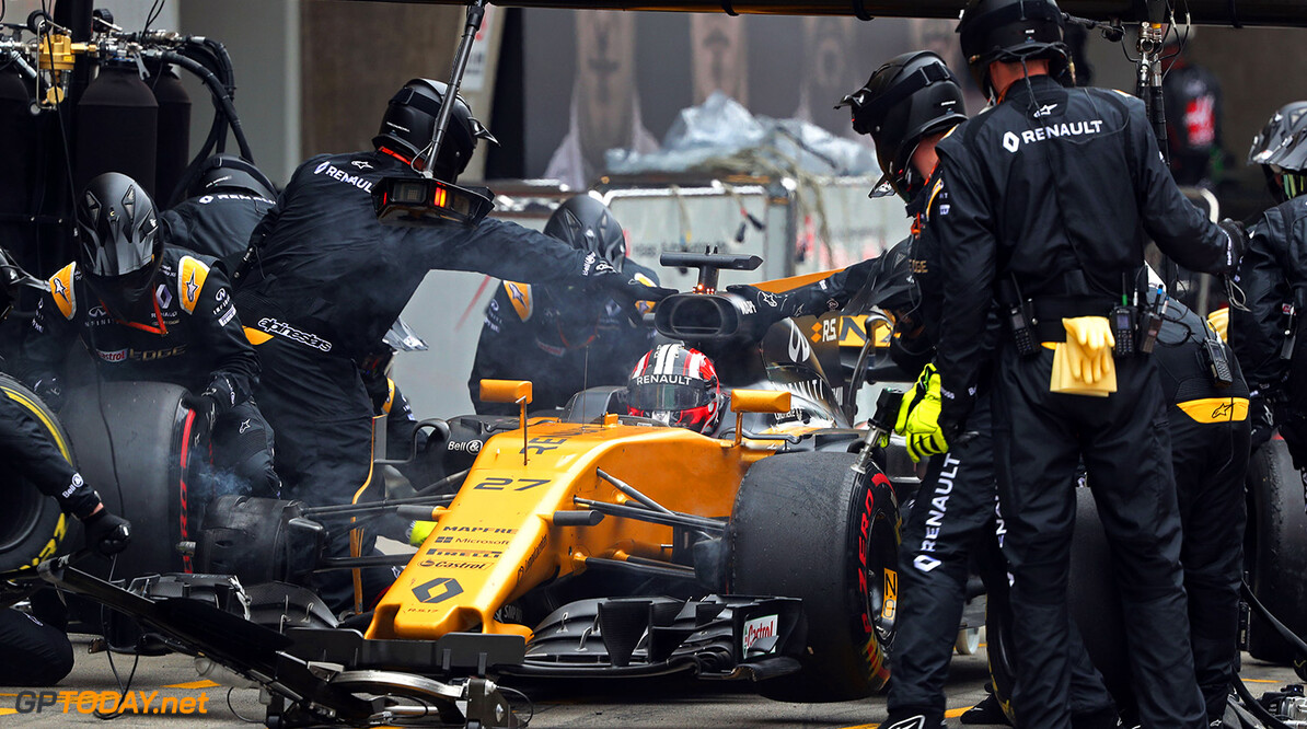 Formula One World Championship Nico Hulkenberg (GER) Renault Sport F1 Team RS17 makes a pit stop. Chinese Grand Prix, Sunday 9th April 2017. Shanghai, China. Motor Racing - Formula One World Championship - Chinese Grand Prix - Race Day - Shanghai, China Renault Sport Formula One Team Shanghai China  Formula One Formula 1 F1 GP Grand Prix China Chinese Shanghai Shanghai International Circuit JM688 Pit Stop Pitstop Hulkenberg H?lkenberg Huelkenberg Action Track GP1702d