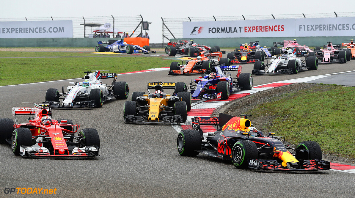 SHANGHAI, CHINA - APRIL 09: Daniel Ricciardo of Australia driving the (3) Red Bull Racing Red Bull-TAG Heuer RB13 TAG Heuer leads Kimi Raikkonen of Finland driving the (7) Scuderia Ferrari SF70H and others into turn 3 at the start during the Formula One Grand Prix of China at Shanghai International Circuit on April 9, 2017 in Shanghai, China.  (Photo by Mark Thompson/Getty Images) // Getty Images / Red Bull Content Pool  // P-20170409-00597 // Usage for editorial use only // Please go to www.redbullcontentpool.com for further information. //  F1 Grand Prix of China Mark Thompson  China  P-20170409-00597