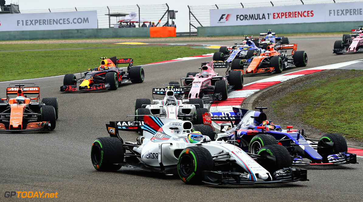 SHANGHAI, CHINA - APRIL 09: Daniil Kvyat of Russia driving the (26) Scuderia Toro Rosso STR12 battles with Felipe Massa of Brazil driving the (19) Williams Martini Racing Williams FW40 Mercedes into turn 3 at the start during the Formula One Grand Prix of China at Shanghai International Circuit on April 9, 2017 in Shanghai, China.  (Photo by Mark Thompson/Getty Images) // Getty Images / Red Bull Content Pool  // P-20170409-00558 // Usage for editorial use only // Please go to www.redbullcontentpool.com for further information. //  F1 Grand Prix of China Mark Thompson  China  P-20170409-00558