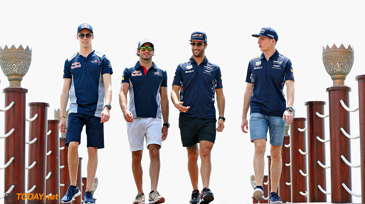 BAHRAIN, BAHRAIN - APRIL 13:  Daniil Kvyat of Russia and Scuderia Toro Rosso, Carlos Sainz of Spain and Scuderia Toro Rosso, Daniel Ricciardo of Australia and Red Bull Racing and Max Verstappen of Netherlands and Red Bull Racing walk during previews to the Bahrain Formula One Grand Prix at Bahrain International Circuit on April 13, 2017 in Bahrain, Bahrain.  (Photo by Mark Thompson/Getty Images) // Getty Images / Red Bull Content Pool  // P-20170413-00917 // Usage for editorial use only // Please go to www.redbullcontentpool.com for further information. //  F1 Grand Prix of Bahrain - Previews Mark Thompson  Bahrain  P-20170413-00917
