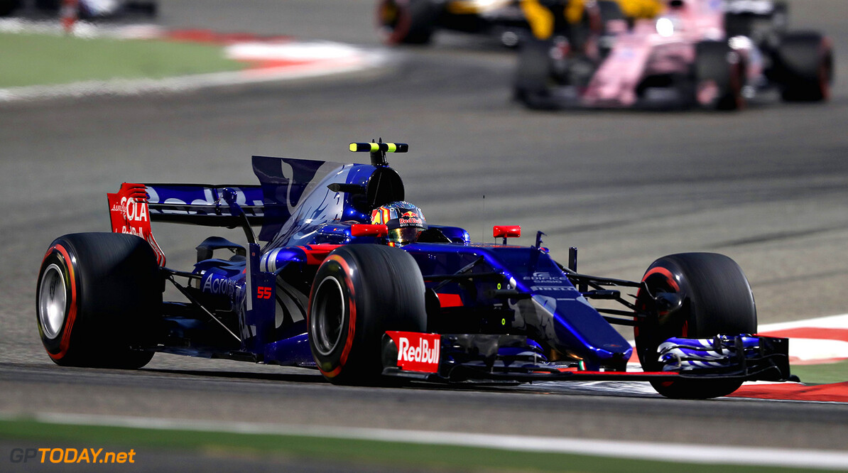 BAHRAIN, BAHRAIN - APRIL 16: Carlos Sainz of Spain driving the (55) Scuderia Toro Rosso STR12 on track during the Bahrain Formula One Grand Prix at Bahrain International Circuit on April 16, 2017 in Bahrain, Bahrain.  (Photo by Mark Thompson/Getty Images) // Getty Images / Red Bull Content Pool  // P-20170416-01191 // Usage for editorial use only // Please go to www.redbullcontentpool.com for further information. //  F1 Grand Prix of Bahrain Mark Thompson  Bahrain  P-20170416-01191