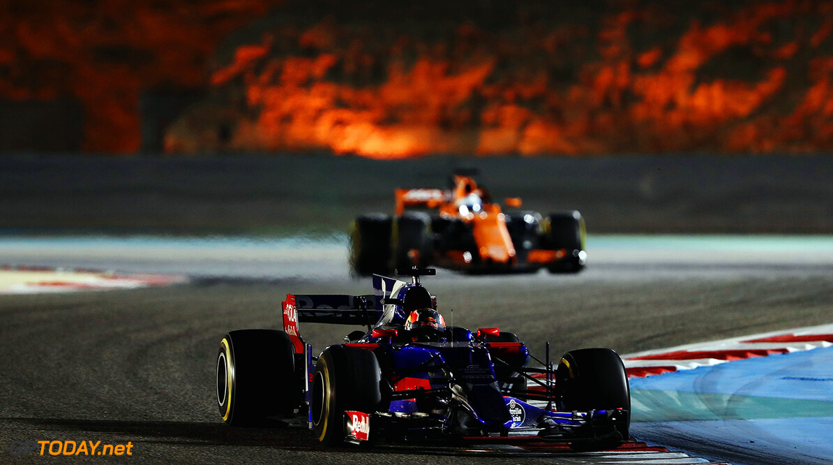BAHRAIN, BAHRAIN - APRIL 16: Daniil Kvyat of Russia driving the (26) Scuderia Toro Rosso STR12 leads Fernando Alonso of Spain driving the (14) McLaren Honda Formula 1 Team McLaren MCL32 on track during the Bahrain Formula One Grand Prix at Bahrain International Circuit on April 16, 2017 in Bahrain, Bahrain.  (Photo by Mark Thompson/Getty Images) // Getty Images / Red Bull Content Pool  // P-20170416-01369 // Usage for editorial use only // Please go to www.redbullcontentpool.com for further information. //  F1 Grand Prix of Bahrain Mark Thompson  Bahrain  P-20170416-01369