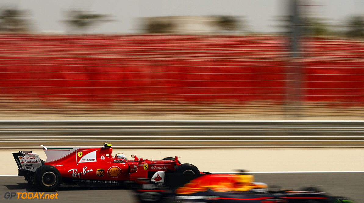 Bahrain International Circuit, Sakhir, Bahrain.  Tuesday 18 April 2017. Daniel Ricciardo, Red Bull Racing RB13 TAG Heuer, leads Sebastian Vettel, Ferrari SF70H. World Copyright: Glenn Dunbar/LAT Images ref: Digital Image _31I3997  Glenn Dunbar    f1 formula 1 formula one test Action