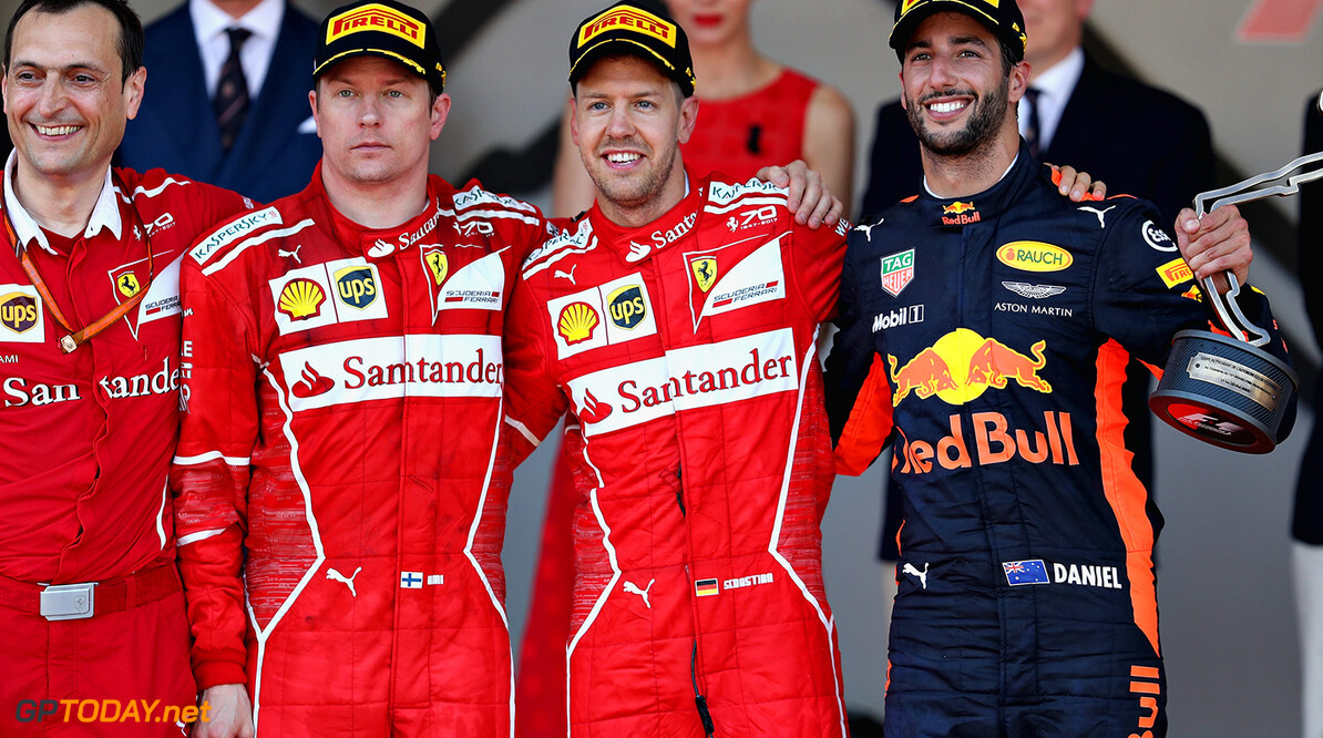 MONTE-CARLO, MONACO - MAY 28: Top three finishers Sebastian Vettel of Germany and Ferrari, Kimi Raikkonen of Finland and Ferrari and Daniel Ricciardo of Australia and Red Bull Racing on the podium during the Monaco Formula One Grand Prix at Circuit de Monaco on May 28, 2017 in Monte-Carlo, Monaco.  (Photo by Mark Thompson/Getty Images) // Getty Images / Red Bull Content Pool  // P-20170528-00765 // Usage for editorial use only // Please go to www.redbullcontentpool.com for further information. //  F1 Grand Prix of Monaco Mark Thompson Monte-Carlo (City) Monaco  P-20170528-00765