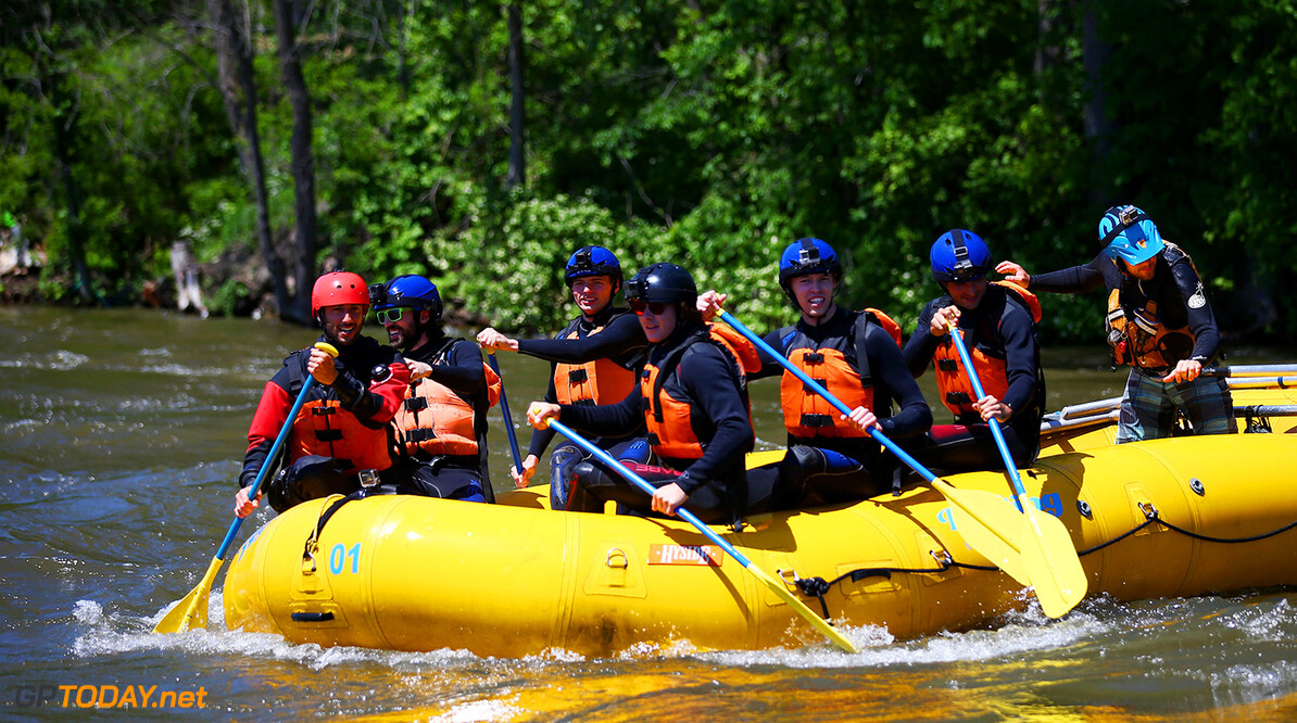 MONTREAL, QC - JUNE 07:  Charles Hamelin, Carlos Sainz of Spain and Scuderia Toro Rosso, Max Verstappen of the Netherlands and Red Bull Racing, Daniel Ricciardo of Australia and Red Bull Racing, Daniil Kvyat of Russia and Scuderia Toro Rosso and Sebastien Toutant take part in a rafting session in the Lachine Rapids on the Saint Lawrence River at Montreal Rafting during previews to the Canadian Formula One Grand Prix on June 7, 2017 in Montreal, Canada.  (Photo by Dan Istitene/Getty Images) // Getty Images / Red Bull Content Pool  // P-20170607-01269 // Usage for editorial use only // Please go to www.redbullcontentpool.com for further information. //  Canadian F1 Grand Prix - Previews Dan Istitene Montreal (City) Canada  P-20170607-01269