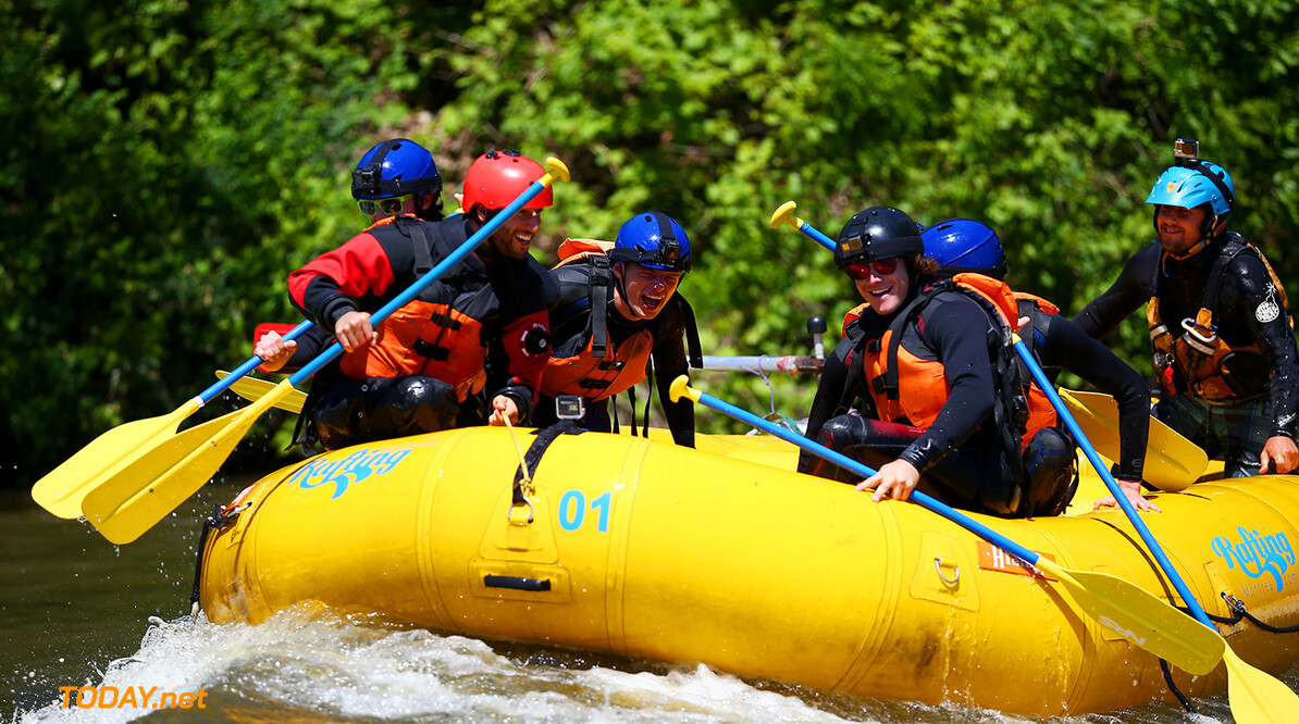 MONTREAL, QC - JUNE 07:  Charles Hamelin, Carlos Sainz of Spain and Scuderia Toro Rosso, Max Verstappen of the Netherlands and Red Bull Racing, Daniel Ricciardo of Australia and Red Bull Racing, Daniil Kvyat of Russia and Scuderia Toro Rosso and Sebastien Toutant take part in a rafting session in the Lachine Rapids on the Saint Lawrence River at Montreal Rafting during previews to the Canadian Formula One Grand Prix on June 7, 2017 in Montreal, Canada.  (Photo by Dan Istitene/Getty Images) // Getty Images / Red Bull Content Pool  // P-20170607-01293 // Usage for editorial use only // Please go to www.redbullcontentpool.com for further information. //  Canadian F1 Grand Prix - Previews Dan Istitene Montreal (City) Canada  P-20170607-01293