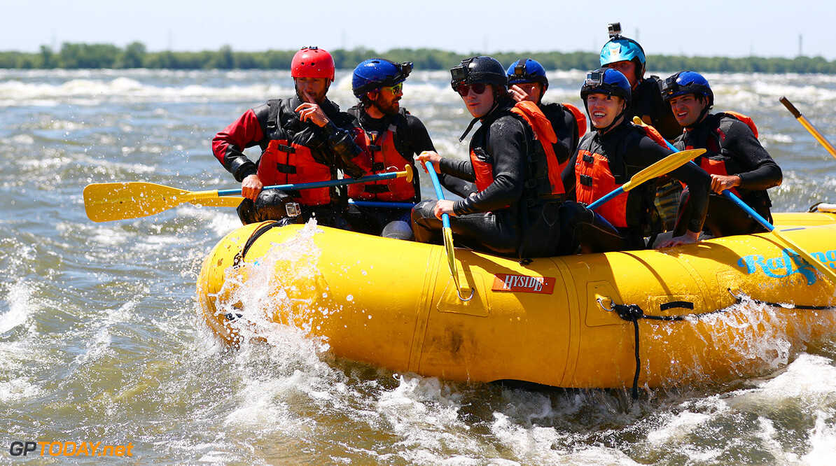 MONTREAL, QC - JUNE 07:  Charles Hamelin, Carlos Sainz of Spain and Scuderia Toro Rosso, Max Verstappen of the Netherlands and Red Bull Racing, Daniel Ricciardo of Australia and Red Bull Racing, Daniil Kvyat of Russia and Scuderia Toro Rosso and Sebastien Toutant take part in a rafting session in the Lachine Rapids on the Saint Lawrence River at Montreal Rafting during previews to the Canadian Formula One Grand Prix on June 7, 2017 in Montreal, Canada.  (Photo by Dan Istitene/Getty Images) // Getty Images / Red Bull Content Pool  // P-20170607-01263 // Usage for editorial use only // Please go to www.redbullcontentpool.com for further information. //  Canadian F1 Grand Prix - Previews Dan Istitene Montreal (City) Canada  P-20170607-01263