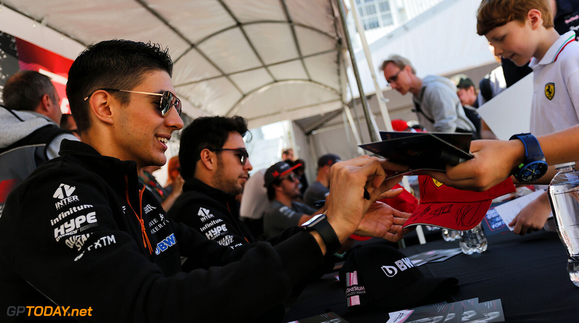 Formula One World Championship Esteban Ocon (FRA) Sahara Force India F1 Team and Sergio Perez (MEX) Sahara Force India F1 sign autographs for the fans. Canadian Grand Prix, Thursday 8th June 2017. Montreal, Canada. Motor Racing - Formula One World Championship - Canadian Grand Prix - Preparation Day - Montreal, Canada James Moy Photography Montreal Canada  Formula One Formula 1 F1 GP Grand Prix Canada Canadian Montreal Ille Notre Dame Circuit JM716 Sergio P?rez Sergio P?rez Mendoza Checo Perez Checo P?rez Crowd Fans Spectators Audience Banner Portrait GP1707a GP1707a_M