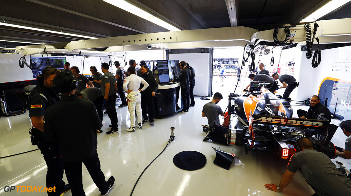 Circuit Gilles Villeneuve, Montreal, Canada. Friday 9 June 2017. Fernando Alonso, McLaren, speaks with Yusuke Hasegawa, Senior Managing Officer, Honda, as the team work on his car in the garage. Photo: Steven Tee/McLaren ref: Digital Image _O3I8084  Steven Tee    f1 formula 1 formula one gp grand prix Portrait Technical Garages