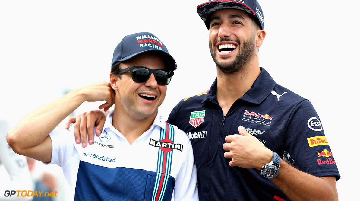 MONTREAL, QC - JUNE 09: Daniel Ricciardo of Australia and Red Bull Racing and Felipe Massa of Brazil and Williams share a joke in the Paddock during practice for the Canadian Formula One Grand Prix at Circuit Gilles Villeneuve on June 9, 2017 in Montreal, Canada.  (Photo by Mark Thompson/Getty Images) // Getty Images / Red Bull Content Pool  // P-20170609-02552 // Usage for editorial use only // Please go to www.redbullcontentpool.com for further information. //  Canadian F1 Grand Prix - Practice Mark Thompson  Canada  P-20170609-02552