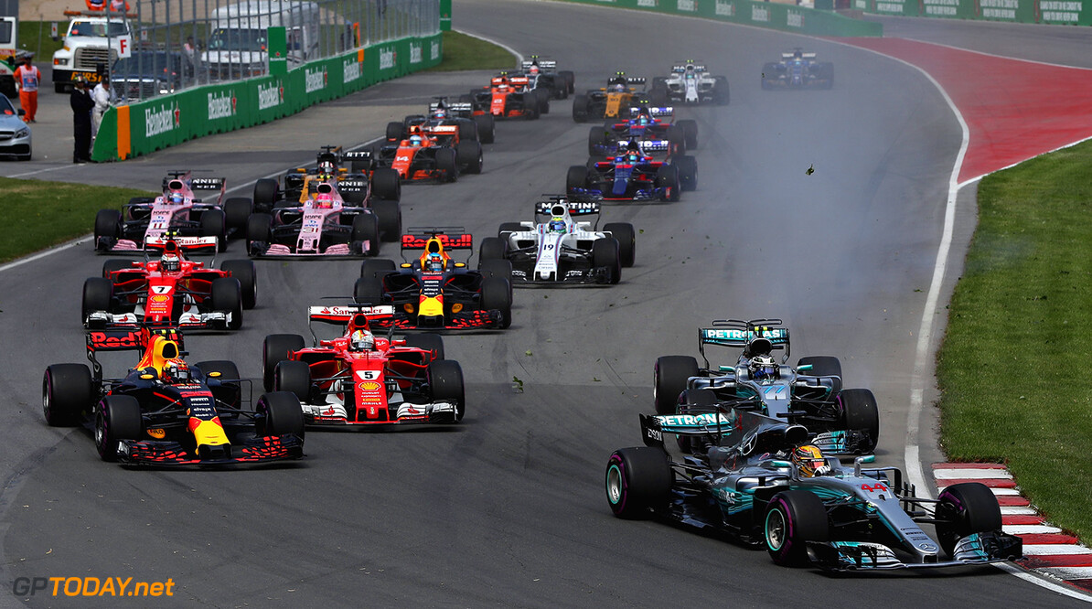 MONTREAL, QC - JUNE 11:Lewis Hamilton of Great Britain driving the (44) Mercedes AMG Petronas F1 Team Mercedes F1 WO8 leads Max Verstappen of the Netherlands driving the (33) Red Bull Racing Red Bull-TAG Heuer RB13 TAG Heuer Valtteri Bottas driving the (77) Mercedes AMG Petronas F1 Team Mercedes F1 WO8 and the rest of the field at the start  during the Canadian Formula One Grand Prix at Circuit Gilles Villeneuve on June 11, 2017 in Montreal, Canada.  (Photo by Mark Thompson/Getty Images) // Getty Images / Red Bull Content Pool  // P-20170611-01653 // Usage for editorial use only // Please go to www.redbullcontentpool.com for further information. //  Canadian F1 Grand Prix Mark Thompson  Canada  P-20170611-01653