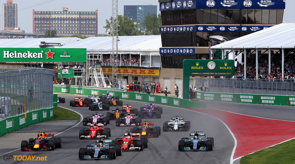 MONTREAL, QC - JUNE 11: Lewis Hamilton of Great Britain driving the (44) Mercedes AMG Petronas F1 Team Mercedes F1 WO8 leads Valtteri Bottas driving the (77) Mercedes AMG Petronas F1 Team Mercedes F1 WO8 Sebastian Vettel of Germany driving the (5) Scuderia Ferrari SF70H Max Verstappen of the Netherlands driving the (33) Red Bull Racing Red Bull-TAG Heuer RB13 TAG Heuer and the rest of the field towards the first corner during the Canadian Formula One Grand Prix at Circuit Gilles Villeneuve on June 11, 2017 in Montreal, Canada.  (Photo by Mark Thompson/Getty Images) // Getty Images / Red Bull Content Pool  // P-20170612-00109 // Usage for editorial use only // Please go to www.redbullcontentpool.com for further information. //  Canadian F1 Grand Prix Mark Thompson  Canada  P-20170612-00109