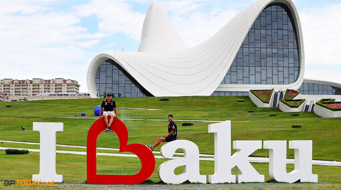 BAKU, AZERBAIJAN - JUNE 22:  Daniel Ricciardo of Australia and Red Bull Racing and Max Verstappen of Netherlands and Red Bull Racing pose for a photo at the Heydar Aliyev Centre during previews ahead of the European Formula One Grand Prix at Baku City Circuit on June 22, 2017 in Baku, Azerbaijan.  (Photo by Mark Thompson/Getty Images) // Getty Images / Red Bull Content Pool  // P-20170622-01086 // Usage for editorial use only // Please go to www.redbullcontentpool.com for further information. //  European F1 Grand Prix - Previews Mark Thompson Baku Azerbaijan  P-20170622-01086
