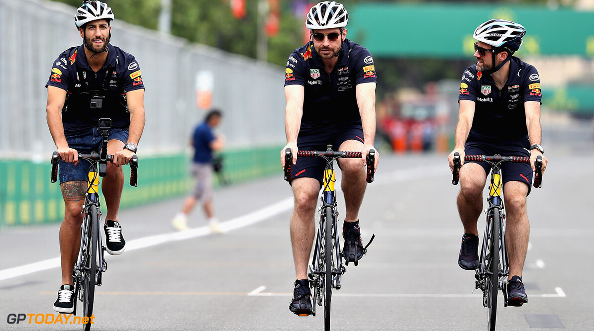 BAKU, AZERBAIJAN - JUNE 22: Daniel Ricciardo of Australia and Red Bull Racing cycles the track with race engineer Simon Rennie during previews ahead of the European Formula One Grand Prix at Baku City Circuit on June 22, 2017 in Baku, Azerbaijan.  (Photo by Mark Thompson/Getty Images) // Getty Images / Red Bull Content Pool  // P-20170622-01021 // Usage for editorial use only // Please go to www.redbullcontentpool.com for further information. //  European F1 Grand Prix - Previews Mark Thompson Baku Azerbaijan  P-20170622-01021