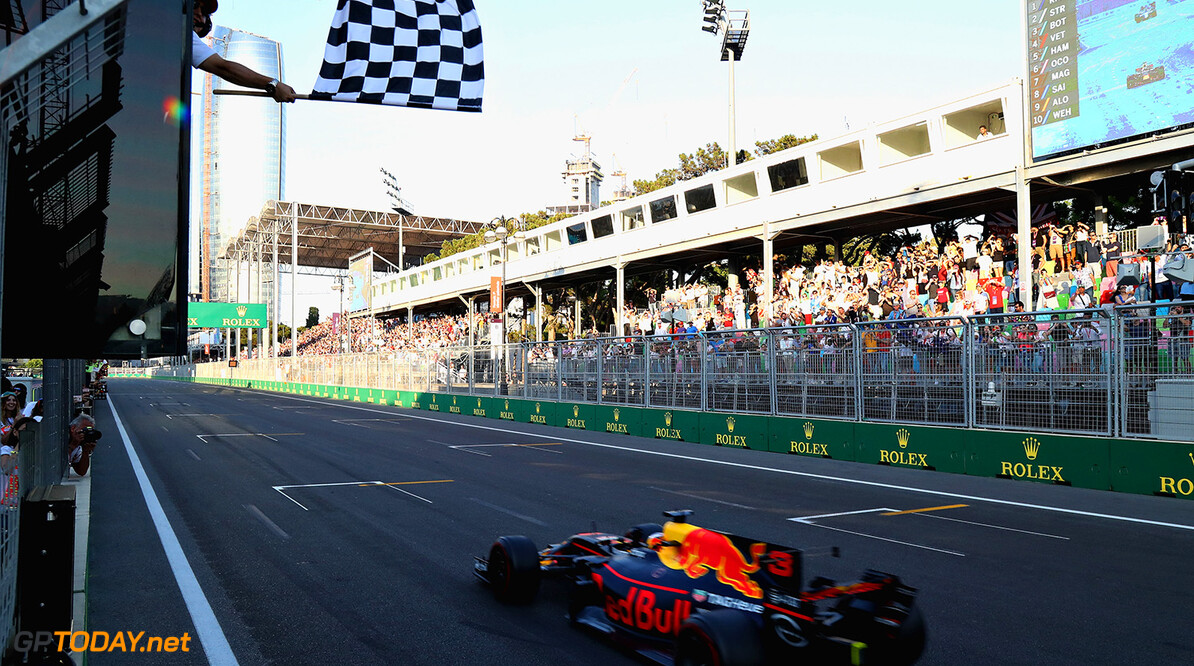 BAKU, AZERBAIJAN - JUNE 25: Daniel Ricciardo of Australia driving the (3) Red Bull Racing Red Bull-TAG Heuer RB13 TAG Heuer takes the chequered flag and the win during the Azerbaijan Formula One Grand Prix at Baku City Circuit on June 25, 2017 in Baku, Azerbaijan.  (Photo by Mark Thompson/Getty Images) // Getty Images / Red Bull Content Pool  // P-20170625-00768 // Usage for editorial use only // Please go to www.redbullcontentpool.com for further information. //  Azerbaijan F1 Grand Prix Mark Thompson Baku Azerbaijan  P-20170625-00768