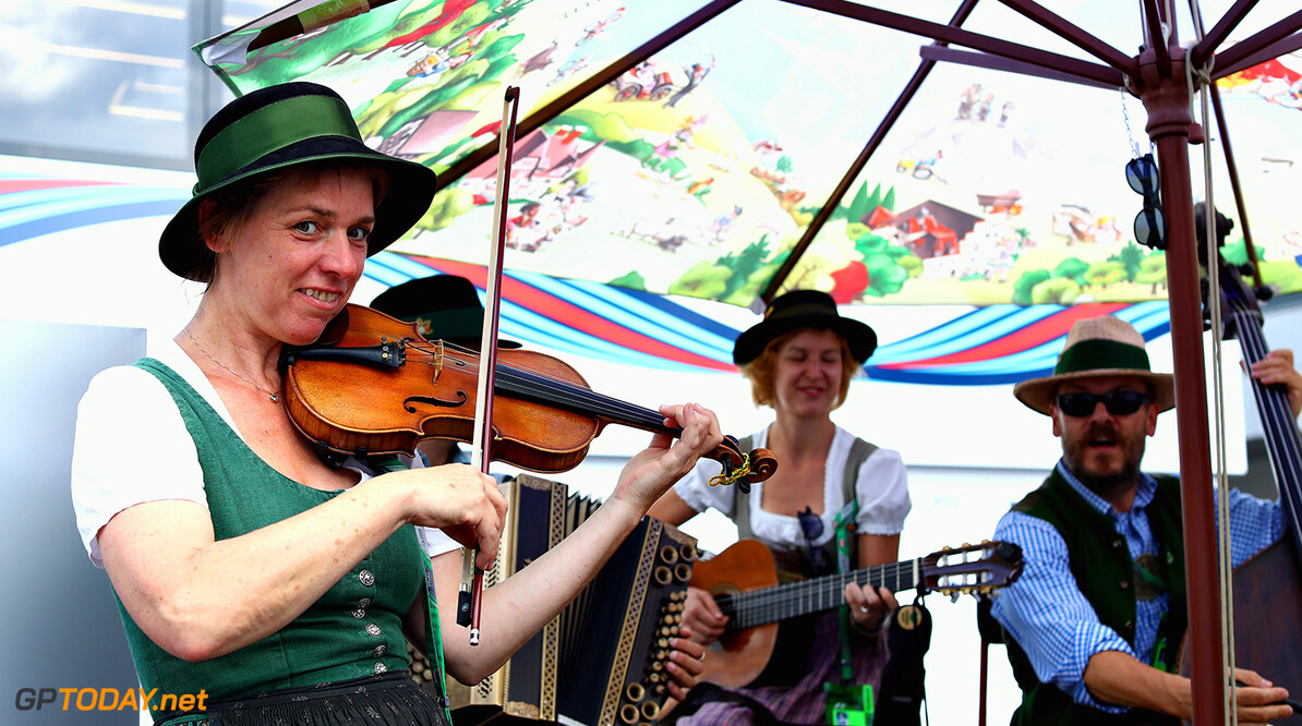 SPIELBERG, AUSTRIA - JULY 06:  Musicians perform in the Paddock during previews ahead of the Formula One Grand Prix of Austria at Red Bull Ring on July 6, 2017 in Spielberg, Austria.  (Photo by Lars Baron/Getty Images) // Getty Images / Red Bull Content Pool  // P-20170706-01482 // Usage for editorial use only // Please go to www.redbullcontentpool.com for further information. //  F1 Grand Prix of Austria - Previews Lars Baron Red Bull Ring Austria  P-20170706-01482