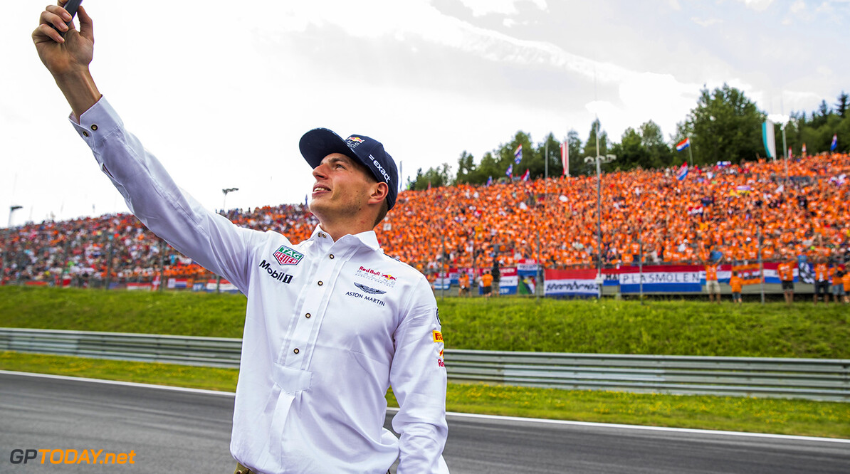 SPIELBERG, AUSTRIA - JULY 09:  Max Verstappen of Netherlands and Red Bull Racing engages with the fans on the drivers parade before the Formula One Grand Prix of Austria at Red Bull Ring on July 9, 2017 in Spielberg, Austria.  (Photo by Mark Thompson/Getty Images) // Getty Images / Red Bull Content Pool  // P-20170709-01559 // Usage for editorial use only // Please go to www.redbullcontentpool.com for further information. //  F1 Grand Prix of Austria  Red Bull Ring Austria  P-20170709-01559