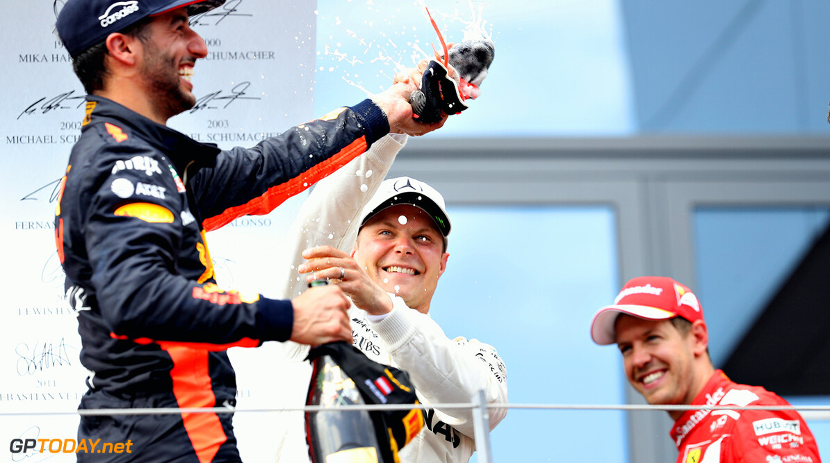 SPIELBERG, AUSTRIA - JULY 09: Race winner Valtteri Bottas of Finland and Mercedes GP tries to avoid doing a shoey on the podium from Daniel Ricciardo of Australia and Red Bull Racing during the Formula One Grand Prix of Austria at Red Bull Ring on July 9, 2017 in Spielberg, Austria.  (Photo by Mark Thompson/Getty Images) // Getty Images / Red Bull Content Pool  // P-20170709-02423 // Usage for editorial use only // Please go to www.redbullcontentpool.com for further information. //  F1 Grand Prix of Austria Mark Thompson Red Bull Ring Austria  P-20170709-02423