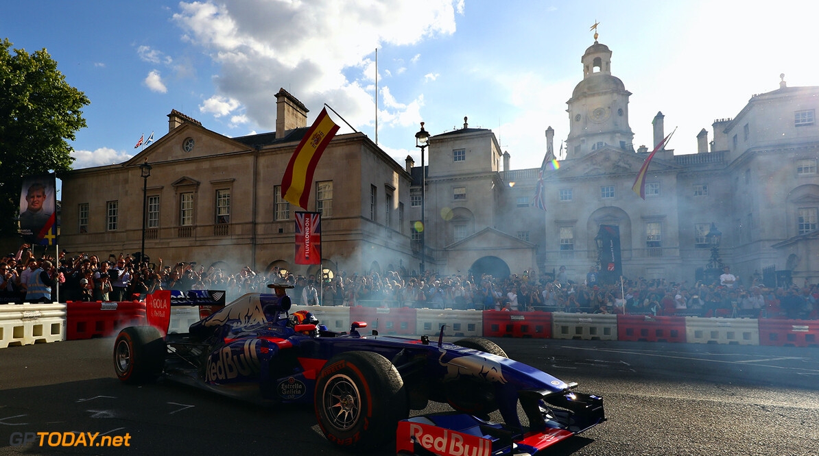 LONDON, ENGLAND - JULY 12:  Carlos Sainz of Spain and Scuderia Toro Rosso driving the Scuderia Toro Rosso STR8 during F1 Live London at Trafalgar Square on July 12, 2017 in London, England.  F1 Live London, the first time in Formula 1 history that all 10 teams come together outside of a race weekend to put on a show for the public in the heart of London.  (Photo by Clive Mason/Getty Images for Formula 1) // Getty Images / Red Bull Content Pool  // P-20170713-00273 // Usage for editorial use only // Please go to www.redbullcontentpool.com for further information. //  F1 Live In London Takes Over Trafalgar Square - Car Parade Clive Mason London United Kingdom  P-20170713-00273