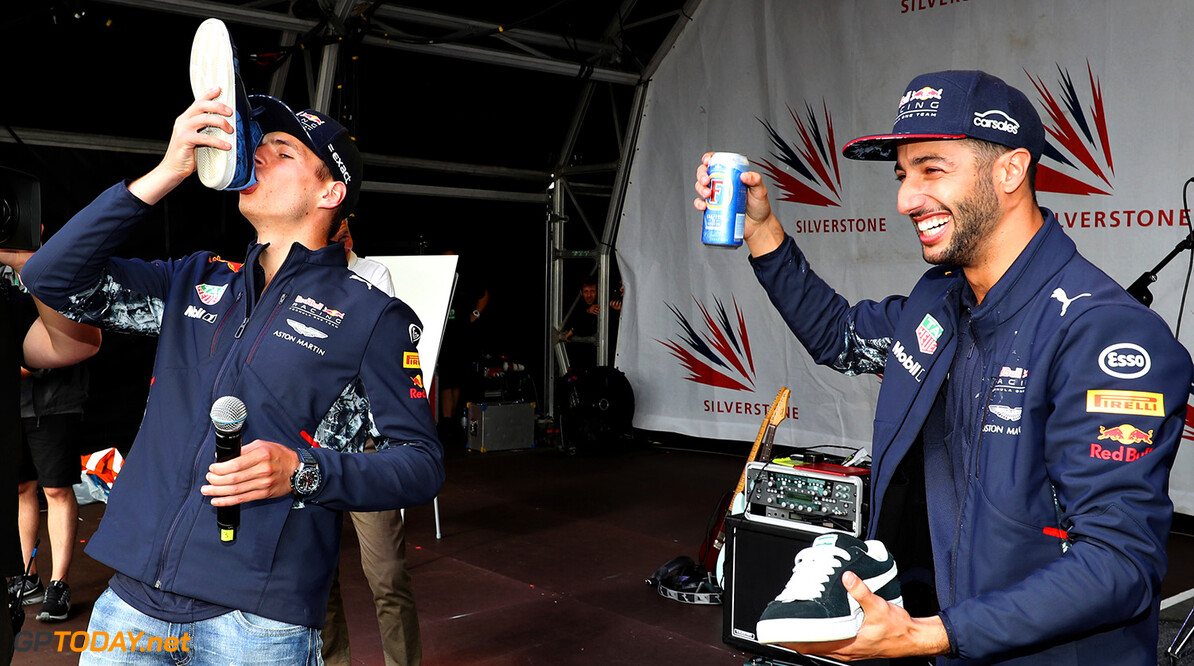 NORTHAMPTON, ENGLAND - JULY 16: Max Verstappen of Netherlands and Red Bull Racing does a shoey with Daniel Ricciardo of Australia and Red Bull Racing on the fans stage after the Formula One Grand Prix of Great Britain at Silverstone on July 16, 2017 in Northampton, England.  (Photo by Mark Thompson/Getty Images) // Getty Images / Red Bull Content Pool  // P-20170716-01455 // Usage for editorial use only // Please go to www.redbullcontentpool.com for further information. //  F1 Grand Prix of Great Britain  Silverstone United Kingdom  P-20170716-01455