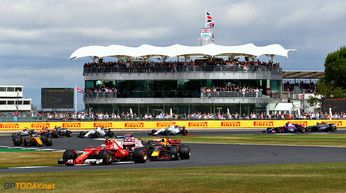 NORTHAMPTON, ENGLAND - JULY 16: Kimi Raikkonen of Finland driving the (7) Scuderia Ferrari SF70H leads Max Verstappen of the Netherlands driving the (33) Red Bull Racing Red Bull-TAG Heuer RB13 TAG Heuer on track during the Formula One Grand Prix of Great Britain at Silverstone on July 16, 2017 in Northampton, England.  (Photo by Clive Mason/Getty Images) // Getty Images / Red Bull Content Pool  // P-20170716-00861 // Usage for editorial use only // Please go to www.redbullcontentpool.com for further information. //  F1 Grand Prix of Great Britain Clive Mason Silverstone United Kingdom  P-20170716-00861
