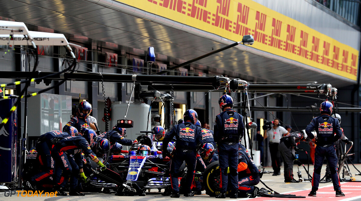 NORTHAMPTON, ENGLAND - JULY 16: Daniil Kvyat of Russia driving the (26) Scuderia Toro Rosso STR12 makes a pit stop during the Formula One Grand Prix of Great Britain at Silverstone on July 16, 2017 in Northampton, England.  (Photo by Mark Thompson/Getty Images) // Getty Images / Red Bull Content Pool  // P-20170716-01228 // Usage for editorial use only // Please go to www.redbullcontentpool.com for further information. //  F1 Grand Prix of Great Britain  Silverstone United Kingdom  P-20170716-01228