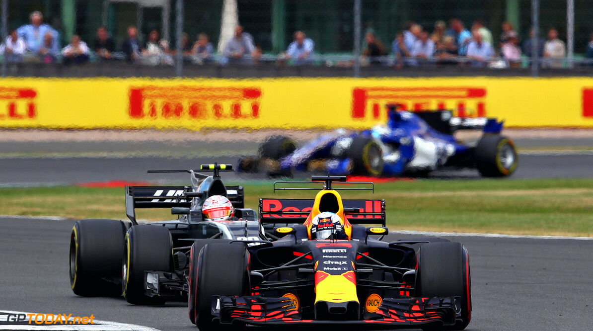 NORTHAMPTON, ENGLAND - JULY 16: Daniel Ricciardo of Australia driving the (3) Red Bull Racing Red Bull-TAG Heuer RB13 TAG Heuer leads Kevin Magnussen of Denmark driving the (20) Haas F1 Team Haas-Ferrari VF-17 Ferrari on track during the Formula One Grand Prix of Great Britain at Silverstone on July 16, 2017 in Northampton, England.  (Photo by Clive Mason/Getty Images) // Getty Images / Red Bull Content Pool  // P-20170716-00843 // Usage for editorial use only // Please go to www.redbullcontentpool.com for further information. //  F1 Grand Prix of Great Britain Clive Mason Silverstone United Kingdom  P-20170716-00843