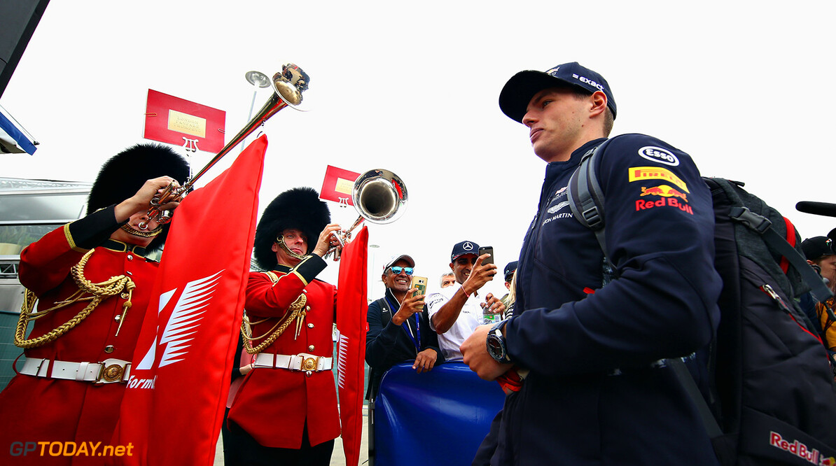 NORTHAMPTON, ENGLAND - JULY 16:  Max Verstappen of Netherlands and Red Bull Racing arrives at the circuit as Queens Guards wearing traditional bearskin hats play horns at the paddock entrance before the Formula One Grand Prix of Great Britain at Silverstone on July 16, 2017 in Northampton, England.  (Photo by Clive Mason/Getty Images) // Getty Images / Red Bull Content Pool  // P-20170716-00783 // Usage for editorial use only // Please go to www.redbullcontentpool.com for further information. //  F1 Grand Prix of Great Britain Clive Mason Silverstone United Kingdom  P-20170716-00783