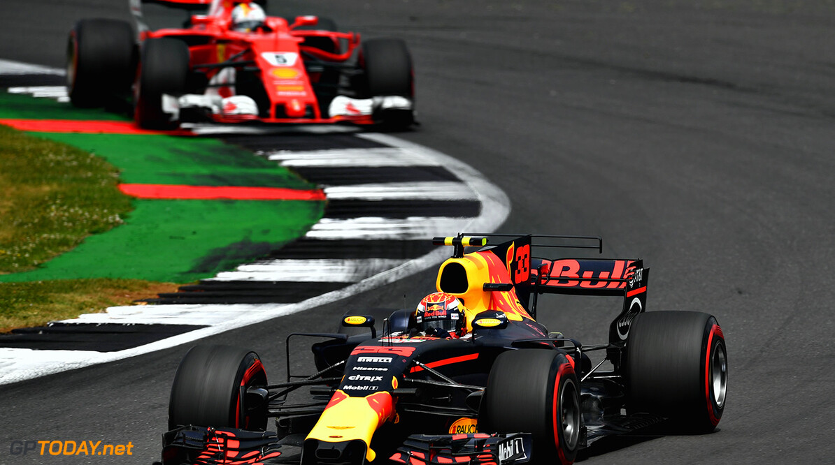 NORTHAMPTON, ENGLAND - JULY 16:  Max Verstappen of the Netherlands driving the (33) Red Bull Racing Red Bull-TAG Heuer RB13 TAG Heuer leads Sebastian Vettel of Germany driving the (5) Scuderia Ferrari SF70H on track during the Formula One Grand Prix of Great Britain at Silverstone on July 16, 2017 in Northampton, England.  (Photo by Dan Mullan/Getty Images) // Getty Images / Red Bull Content Pool  // P-20170716-00846 // Usage for editorial use only // Please go to www.redbullcontentpool.com for further information. //  F1 Grand Prix of Great Britain Dan Mullan Silverstone United Kingdom  P-20170716-00846