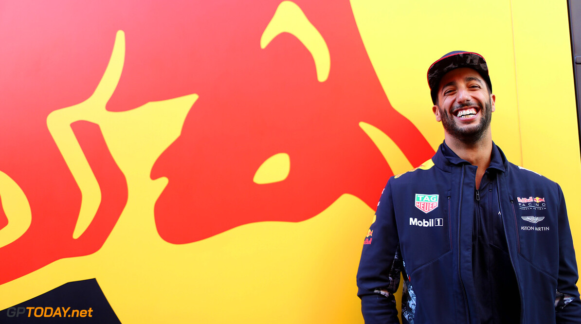 BUDAPEST, HUNGARY - JULY 27:  Daniel Ricciardo of Australia and Red Bull Racing poses for a photo next to a Red Bull Racing truck in the Paddock during previews ahead of the Formula One Grand Prix of Hungary at Hungaroring on July 27, 2017 in Budapest, Hungary.  (Photo by Mark Thompson/Getty Images) // Getty Images / Red Bull Content Pool  // P-20170727-01351 // Usage for editorial use only // Please go to www.redbullcontentpool.com for further information. //  F1 Grand Prix of Hungary - Previews Mark Thompson Budapest Hungary  P-20170727-01351