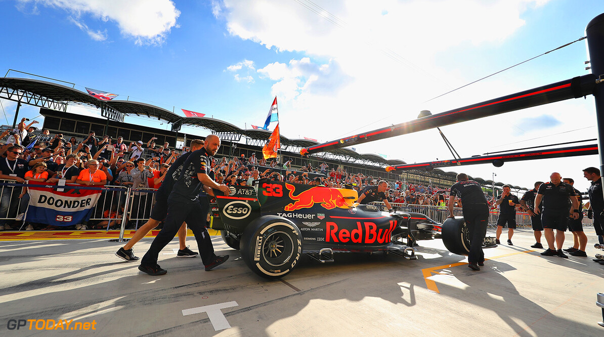 BUDAPEST, HUNGARY - JULY 27:  The car of Max Verstappen of Netherlands and Red Bull Racing is pushed by the Red Bull Racing team in the Pitlane during previews ahead of the Formula One Grand Prix of Hungary at Hungaroring on July 27, 2017 in Budapest, Hungary.  (Photo by Mark Thompson/Getty Images) // Getty Images / Red Bull Content Pool  // P-20170727-01369 // Usage for editorial use only // Please go to www.redbullcontentpool.com for further information. //  F1 Grand Prix of Hungary - Previews Mark Thompson Budapest Hungary  P-20170727-01369