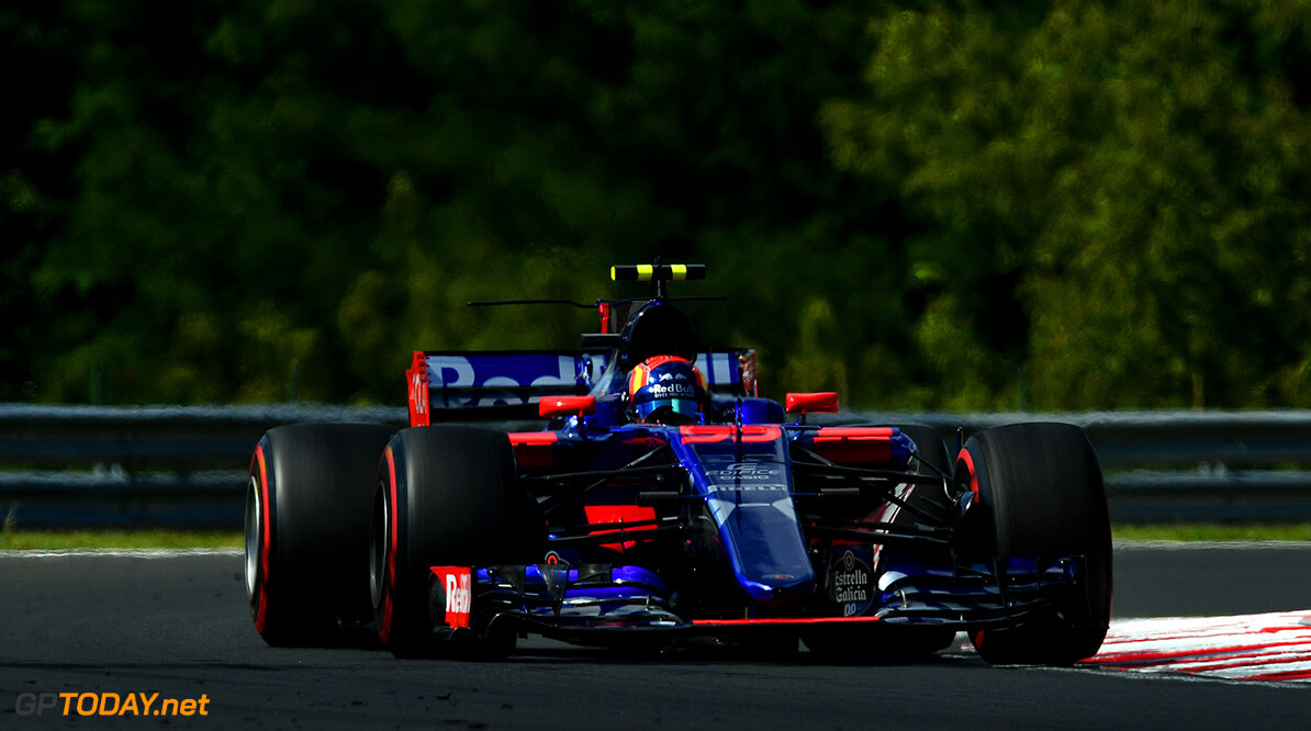 BUDAPEST, HUNGARY - JULY 28: Carlos Sainz of Spain driving the (55) Scuderia Toro Rosso STR12 on track during practice for the Formula One Grand Prix of Hungary at Hungaroring on July 28, 2017 in Budapest, Hungary.  (Photo by Dan Mullan/Getty Images) // Getty Images / Red Bull Content Pool  // P-20170728-02021 // Usage for editorial use only // Please go to www.redbullcontentpool.com for further information. //  F1 Grand Prix of Hungary - Practice Dan Mullan Budapest Hungary  P-20170728-02021