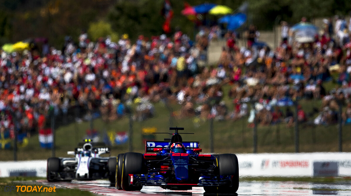 BUDAPEST, HUNGARY - JULY 30: Daniil Kvyat of Russia driving the (26) Scuderia Toro Rosso STR12 on track during the Formula One Grand Prix of Hungary at Hungaroring on July 30, 2017 in Budapest, Hungary.  (Photo by Lars Baron/Getty Images) // Getty Images / Red Bull Content Pool  // P-20170730-01420 // Usage for editorial use only // Please go to www.redbullcontentpool.com for further information. //  F1 Grand Prix of Hungary  Budapest Hungary  P-20170730-01420