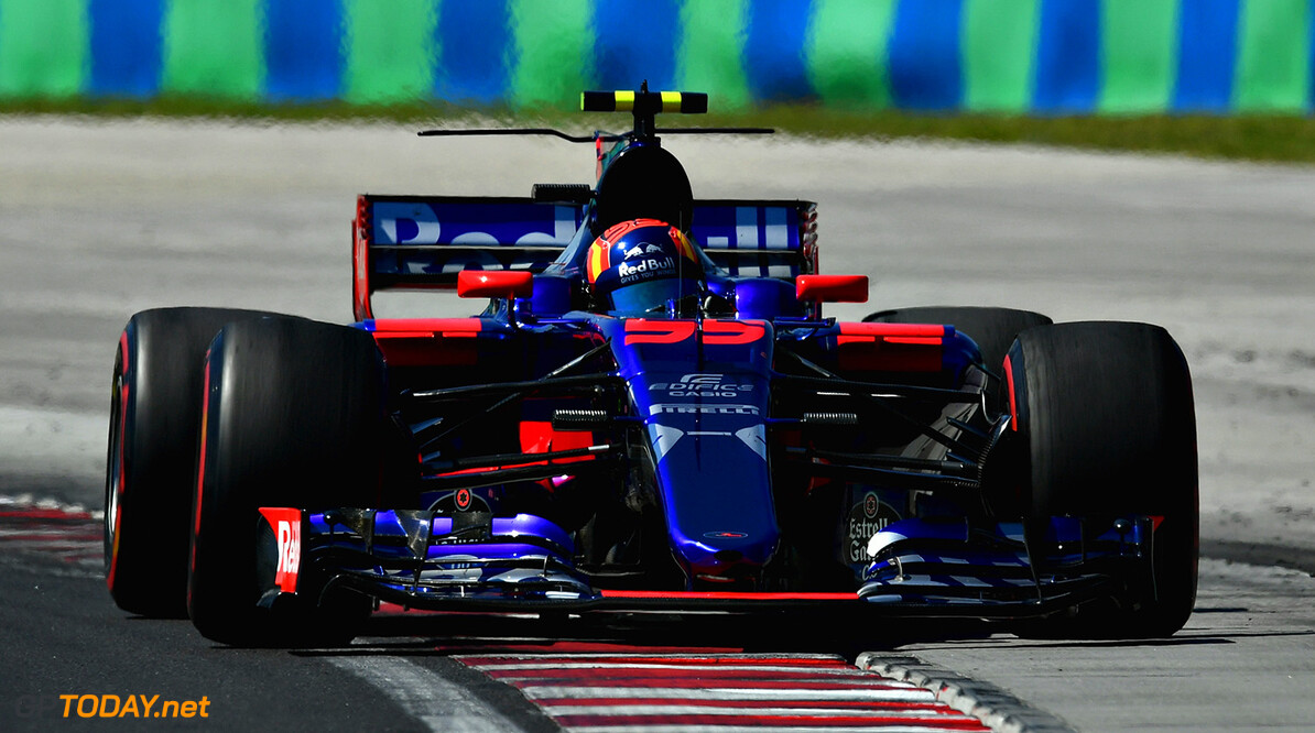 BUDAPEST, HUNGARY - JULY 30: Carlos Sainz of Spain driving the (55) Scuderia Toro Rosso STR12 on track during the Formula One Grand Prix of Hungary at Hungaroring on July 30, 2017 in Budapest, Hungary.  (Photo by Dan Mullan/Getty Images) // Getty Images / Red Bull Content Pool  // P-20170730-00516 // Usage for editorial use only // Please go to www.redbullcontentpool.com for further information. //  F1 Grand Prix of Hungary Dan Mullan Budapest Hungary  P-20170730-00516