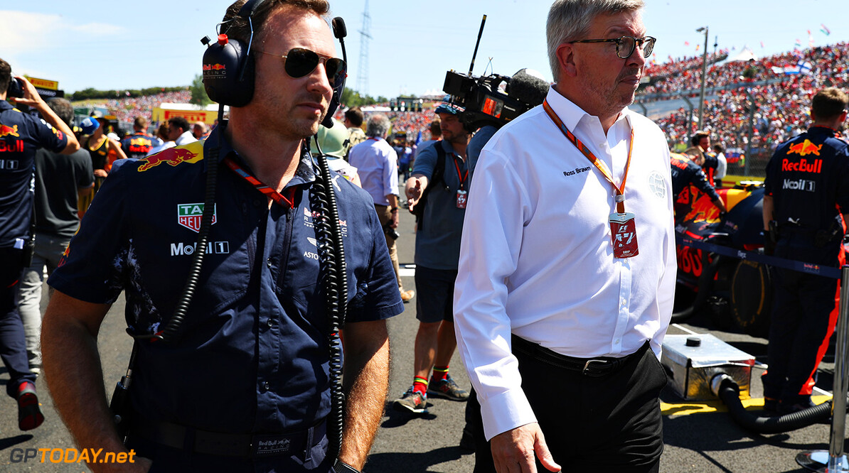 BUDAPEST, HUNGARY - JULY 30: Red Bull Racing Team Principal Christian Horner and Ross Brawn, Managing Director (Sporting) of the Formula One Group walk on the grid before the Formula One Grand Prix of Hungary at Hungaroring on July 30, 2017 in Budapest, Hungary.  (Photo by Mark Thompson/Getty Images) // Getty Images / Red Bull Content Pool  // P-20170730-01465 // Usage for editorial use only // Please go to www.redbullcontentpool.com for further information. //  F1 Grand Prix of Hungary  Budapest Hungary  P-20170730-01465