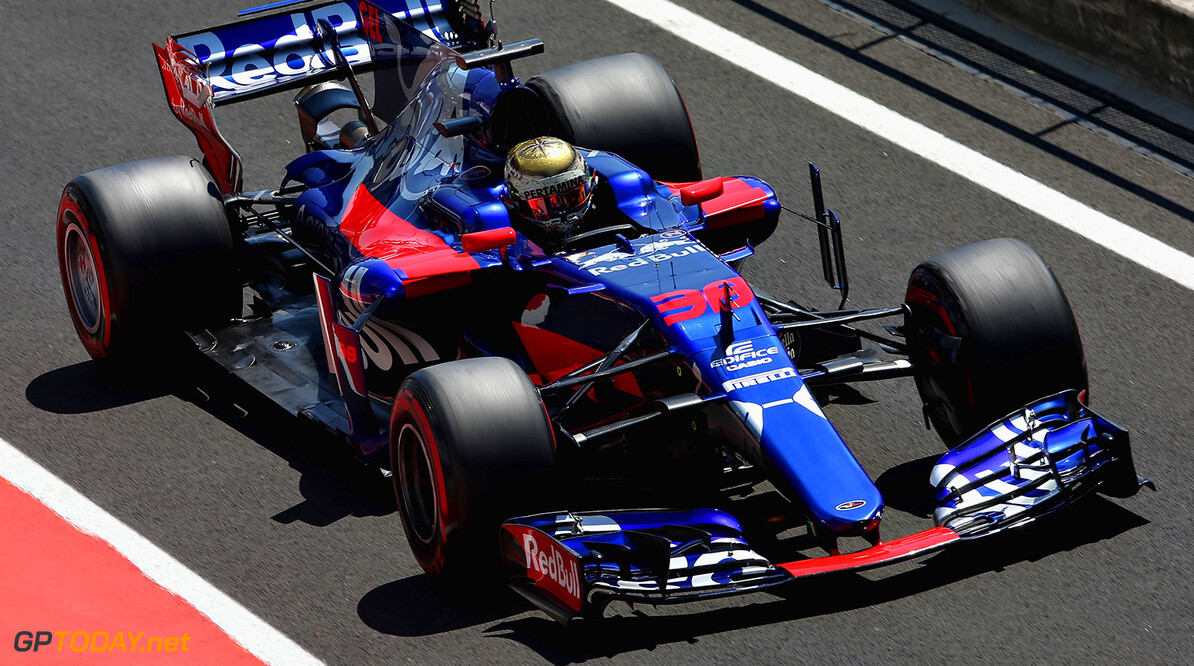BUDAPEST, HUNGARY - AUGUST 01:  Sean Gelael of Indonesia driving the Scuderia Toro Rosso STR12 in the Pitlane  during day one of F1 in-season testing at Hungaroring on August 1, 2017 in Budapest, Hungary.  (Photo by Charles Coates/Getty Images) // Getty Images / Red Bull Content Pool  // P-20170801-00845 // Usage for editorial use only // Please go to www.redbullcontentpool.com for further information. //  F1 In-Season Testing In Budapest - Day One Charles Coates Budapest Hungary  P-20170801-00845