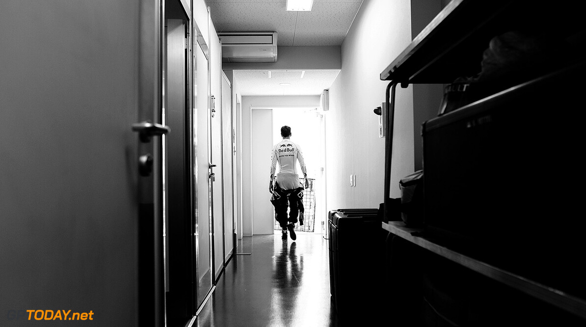 110168581VR007_F1_Grand_Pri SUZUKA, JAPAN - OCTOBER 07:  (EDITORS NOTE: THIS BLACK AND WHITE IMAGE WAS CREATED FROM ORIGINAL COLOUR FILE) Sebastian Vettel of Germany and Red Bull Racing leaves his changing room ahead of the practice session of the Formula One Grand Prix of Japan at Suzuka Circuit on October 7, 2011 in Suzuka, Japan.  (Photo by Vladimir Rys Photography via Getty Images) *** Local Caption *** Sebastian Vettel F1 Grand Prix of Japan - Practice Vladimir Rys Photography Suzuka Japan  Formula One Racing