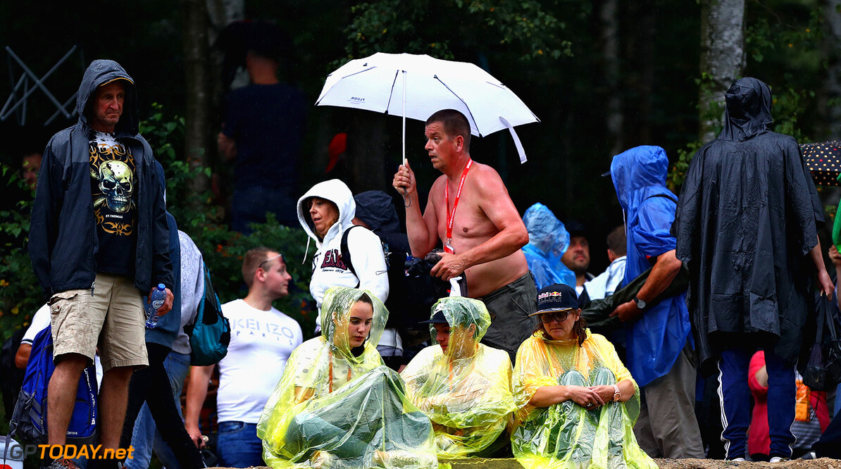 SPA, BELGIUM - AUGUST 25:  Fans attempt to shelter from the rain during practice for the Formula One Grand Prix of Belgium at Circuit de Spa-Francorchamps on August 25, 2017 in Spa, Belgium.  (Photo by Dan Istitene/Getty Images) // Getty Images / Red Bull Content Pool  // P-20170825-01448 // Usage for editorial use only // Please go to www.redbullcontentpool.com for further information. //  F1 Grand Prix of Belgium - Practice Dan Istitene Spa Belgium  P-20170825-01448