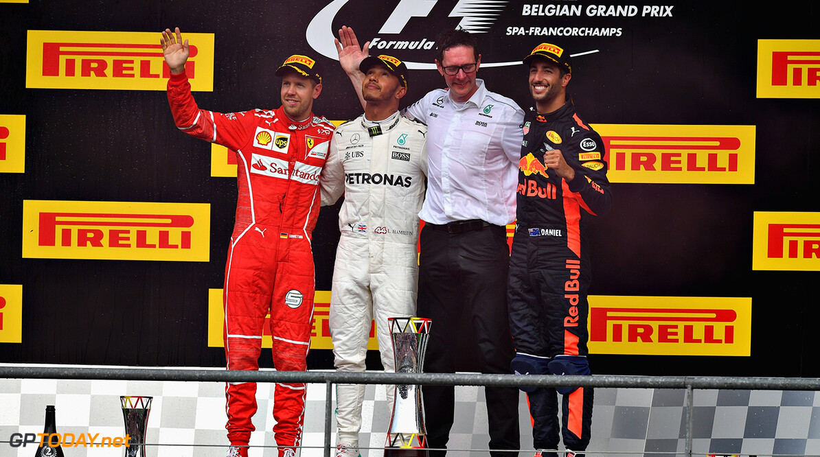SPA, BELGIUM - AUGUST 27:  Top three finishers Lewis Hamilton of Great Britain and Mercedes GP, Sebastian Vettel of Germany and Ferrari and Daniel Ricciardo of Australia and Red Bull Racing on the podium during the Formula One Grand Prix of Belgium at Circuit de Spa-Francorchamps on August 27, 2017 in Spa, Belgium.  (Photo by Dan Mullan/Getty Images) // Getty Images / Red Bull Content Pool  // P-20170827-10051 // Usage for editorial use only // Please go to www.redbullcontentpool.com for further information. //  F1 Grand Prix of Belgium Dan Mullan Spa Belgium  P-20170827-10051