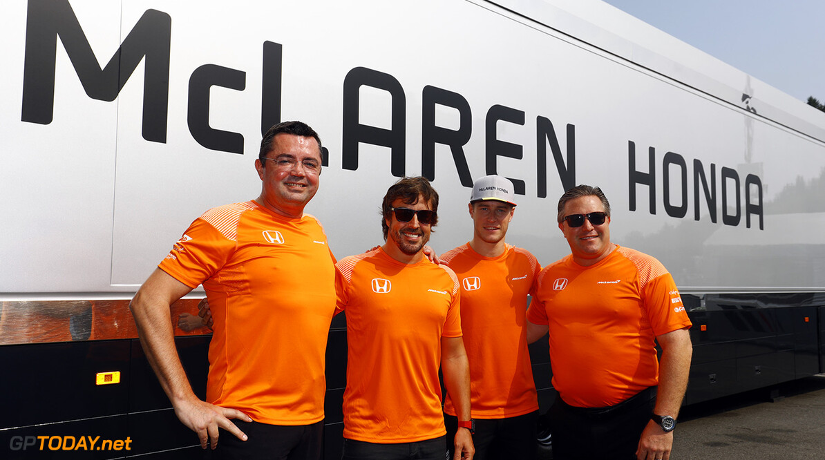 Spa Francorchamps, Belgium.  Sunday 27 August 2017. Eric Boullier, Racing Director, McLaren, Fernando Alonso, McLaren, Stoffel Vandoorne, McLaren, and Zak Brown, Executive Director, McLaren Technology Group, wear celebratory orange T-shirts. Photo: Steven Tee/McLaren ref: Digital Image _R3I0899  Steven Tee    f1 formula 1 formula one gp grand prix Portrait