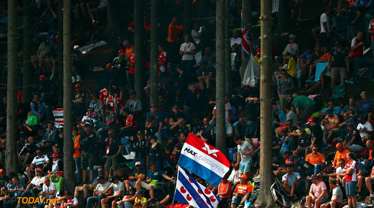 SPA, BELGIUM - AUGUST 27:  Max Verstappen of Netherlands and Red Bull Racing fans take a seat to watch the action before the Formula One Grand Prix of Belgium at Circuit de Spa-Francorchamps on August 27, 2017 in Spa, Belgium.  (Photo by Dan Istitene/Getty Images) // Getty Images / Red Bull Content Pool  // P-20170827-04374 // Usage for editorial use only // Please go to www.redbullcontentpool.com for further information. //  F1 Grand Prix of Belgium Dan Istitene Spa Belgium  P-20170827-04374